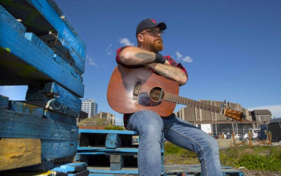 Folk singer and song writer Adam McGrath and his Sit In