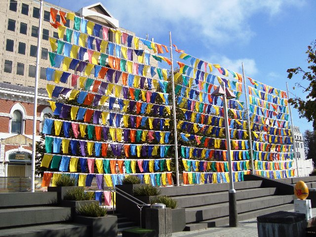 Colourful flags hung in a diamond pattern
