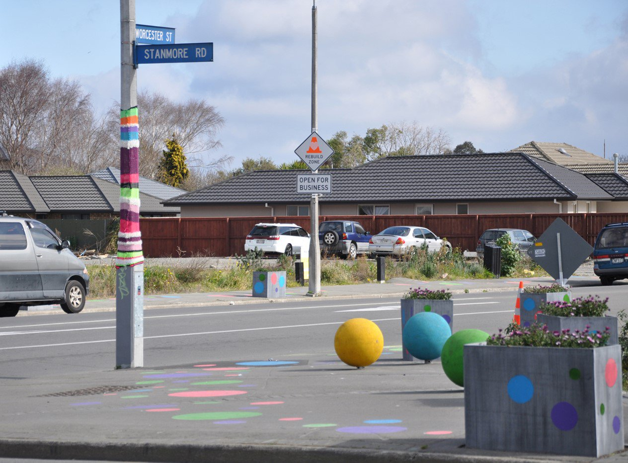 A street corner with painted footpaths and rubber ball seats