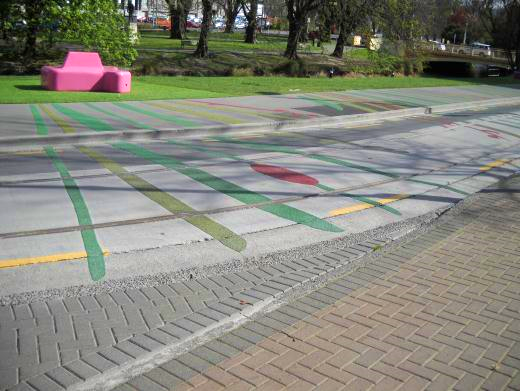 Strips of paint demarcate a shared footpath