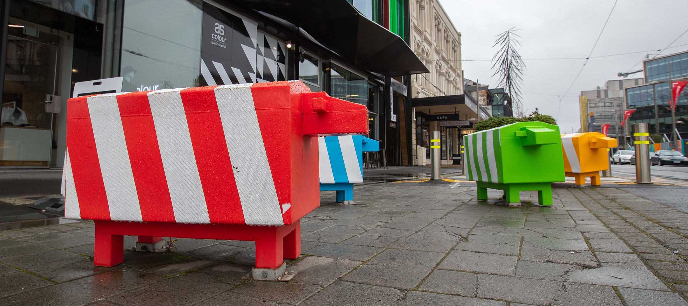 Colourful traffic bollards shaped as sheep