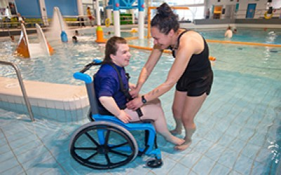Chrystal tries out the new wet wheelchair design at Pioneer Recreation and Sport Centre with her carer Jess.