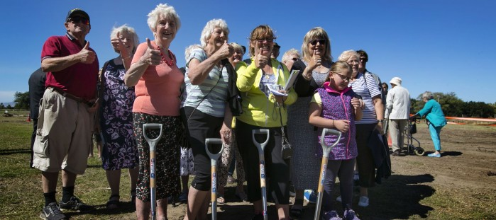 Members of the local community give the thumbs-up to work starting on the new QEII Recreation and Sport Centre.