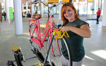 A woman tries out the bike rack.
