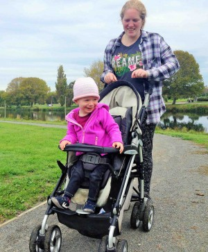 Mother and her child in a pushchair on a Christchurch walking trail.