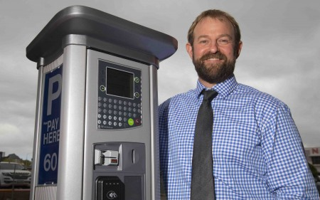 Transport Operations Manager Aaron Haymes with one of the new parking meters.