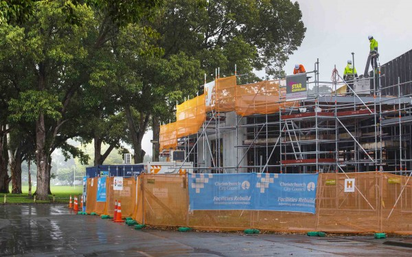 Builders work amid scaffolding at the new Bishopdale Library.
